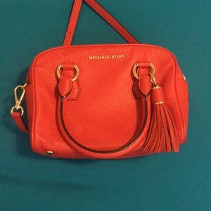Red Michael Kors crossbody bag.